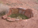 A storage pit at the archeological site. These pits were abandoned by the Ancestral Puebloans about 900 years ago.