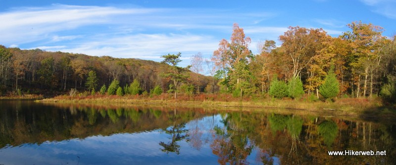 A panoramic shot of reflections on the still water provides tranquility at Lower Blue Mountain Lake.